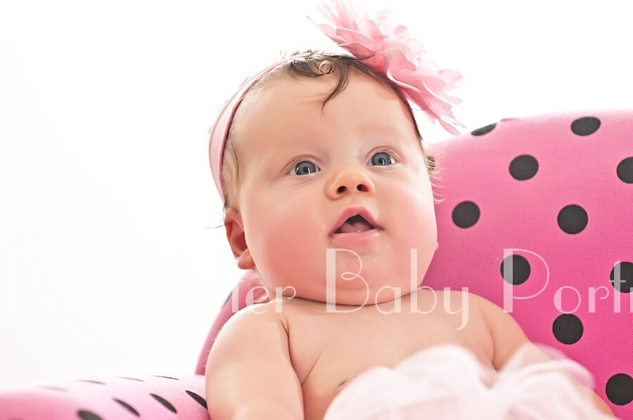 Closeup portrait of baby girl with pink flower headband