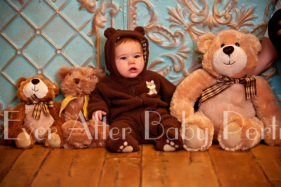 Six month old in teddy bear outfit.