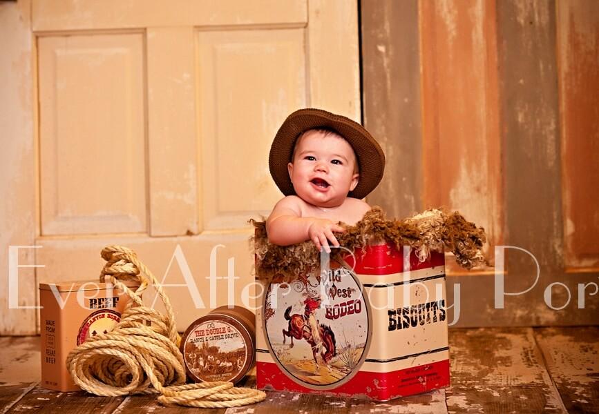 Portrait of little boy in cowboy attire.