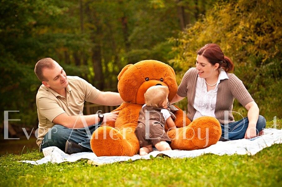 Happy family with teddy bear.