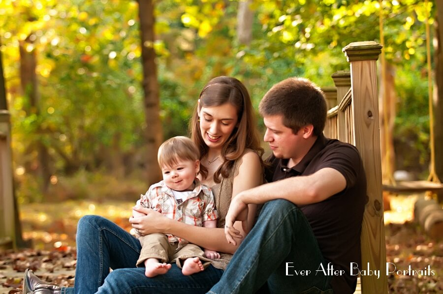 Outdoor image of parents with child.