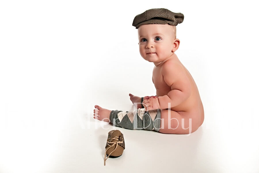 Infant in plaid cap and argyle socks