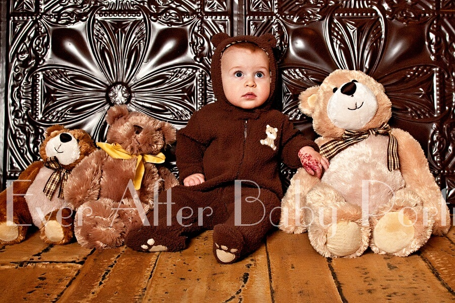 Boy in bear costume with teddy bears.