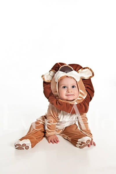 Baby boy in lion costume.