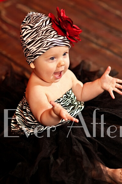 Baby girl in her zebra hat and ensemble.