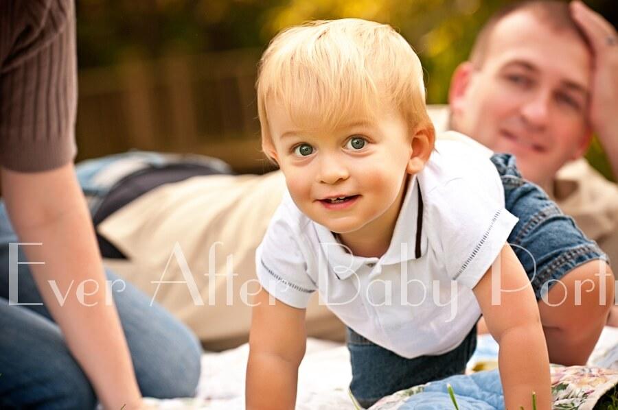 Blonde hair baby boy in closeup image.