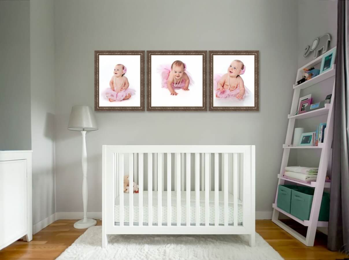Three Framed Baby Portraits Above the Crib