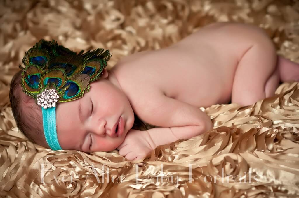 Newborn Baby Portrait on Gold with peacock feather